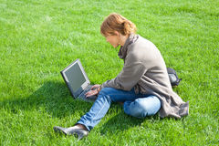 Woman grass laptop Royalty Free Stock Photos