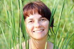 Woman in grass Stock Photos