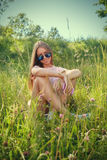 Woman in grass Stock Photo