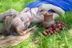 The woman in a grass is a strawberry Stock Photos