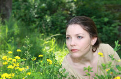 Woman in grass Stock Image
