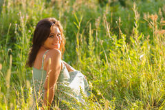 Woman in the grass Stock Image