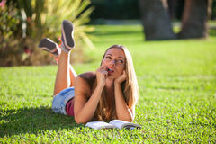 Woman on a grass Stock Photography