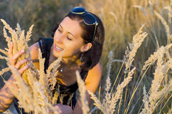 Woman in the grass Royalty Free Stock Image