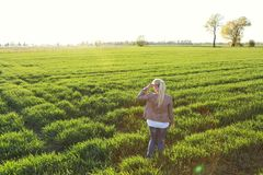 A woman on a grassy field. In summer Stock Photo
