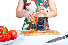 Woman grating carrot isolated on white Stock Photo