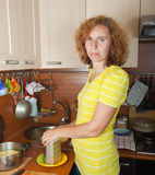Woman grating cheese Stock Photo