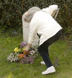 Woman at grave Royalty Free Stock Photography