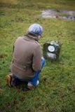 Woman at Grave royalty free stock image
