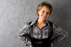 The woman on the gray background Stock Photography
