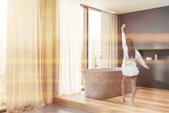 Woman in gray bathroom corner royalty free stock photos