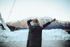Woman in Gray and Black Tribal Cardigan Standing in Front of Snow Fields Stock Photography