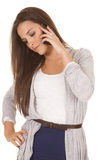 Woman gray and blue outfit phone look down Stock Photo