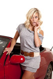 Woman gray by car shock Royalty Free Stock Photography