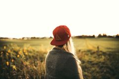 Woman in Gray Cardigan and Red Snapback Cap Stock Image