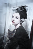 Woman with gray cat Stock Photography