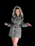 Woman in gray coat on black background Royalty Free Stock Image