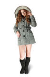 Woman in gray coat and black high shoes. Girl in gray coat on white background Royalty Free Stock Image