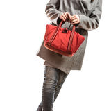 Woman in gray coat holds red handbag Stock Image