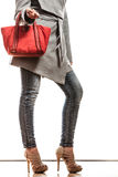 Woman in gray coat holds red handbag Stock Photography