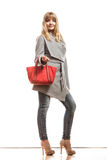 Woman in gray coat holds red handbag Royalty Free Stock Photography
