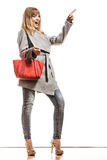 Woman gray coat red handbag showing copy space Stock Images