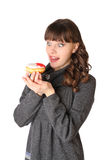 Woman at gray dress with donut Stock Image