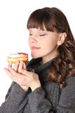 Woman at gray dress with donut Royalty Free Stock Photo