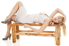 Woman gray dress lay bench Royalty Free Stock Images