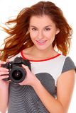 Woman in gray dress wit digtal camera on white Royalty Free Stock Photography