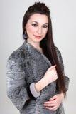 Woman in gray fur coat Royalty Free Stock Image