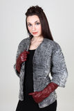 Woman in gray fur coat Stock Image