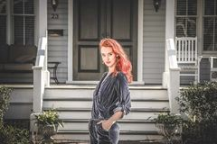Woman in Gray Jumpsuit Standing in Front of House Royalty Free Stock Photography