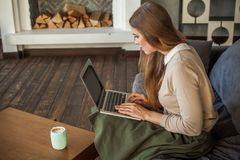 Woman with Laptop. Cute Girl at Home. Woman with gray Laptop. Cute Girl at Home Royalty Free Stock Photography