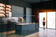 Woman in gray and marble kitchen stock images