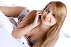 Woman in a gray shirt on the bed Stock Image