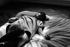 Woman in Gray Shirt in Bed Painting Royalty Free Stock Image
