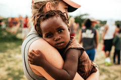 Woman on Gray Shirt Caring African Child With Gray Shirt Stock Images