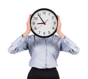 Woman in a shirt holds a round clock Royalty Free Stock Photo