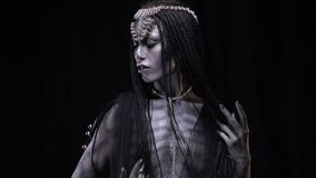 Woman with a gray skin like an alien. Alien girl on earth from space stock video footage