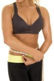 Woman gray sports bra measure waist body Royalty Free Stock Photo
