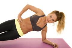 Woman gray sports bra plank side Royalty Free Stock Photo