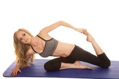 Woman gray sports bra sit stretch lean Stock Photo