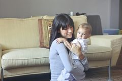 Woman in Gray Sweater Carrying Toddler in White Button-up Shirt Royalty Free Stock Photography