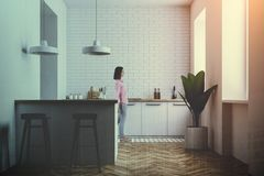 Woman gray and white kitchen interior toned royalty free stock photos