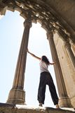 Woman between great columns Royalty Free Stock Photo