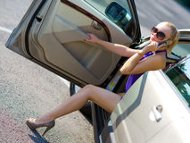 Woman with great legs exit the car Royalty Free Stock Photo