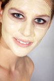 Woman with great makeup and face mask Stock Images