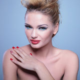 Woman with great makeup and hairstyle with her hand on shoulder Royalty Free Stock Image