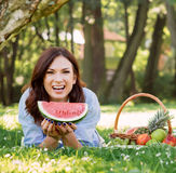 Woman in a great mood having a slice of a watermelon Stock Images